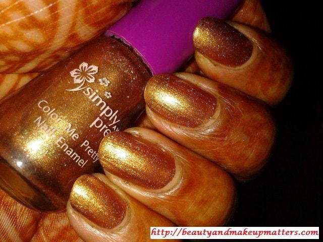 Avon-Simply-Pretty-Nail-Polish-Glitter-Gold-Nail-Swatch