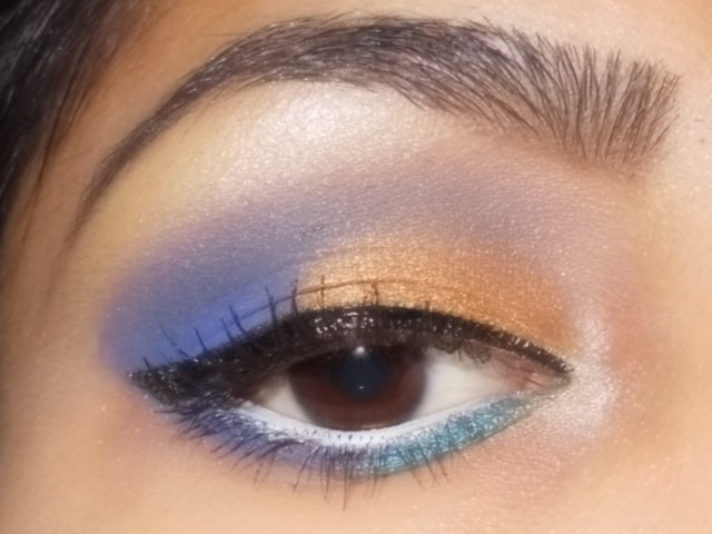Purple and Gold Eye Makeup with White Waterline
