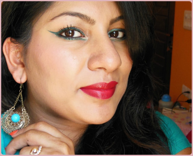 Green Eyes and Red Lips Festive Makeup