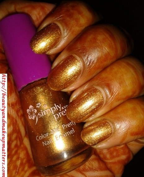Avon-Simply-Pretty-Nail-Polish-Glitter-Gold-NOTD