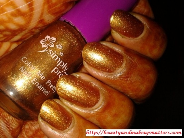 Avon-Simply-Pretty-Nail-Polish-Glitter-Gold-Nail-Swatch