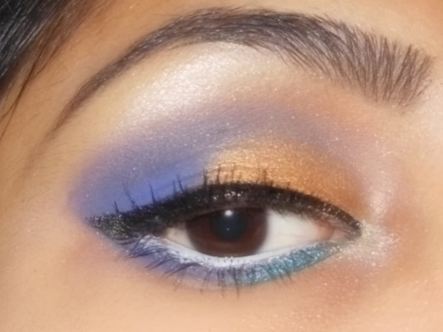 Gold and Purple Eye Makeup with White Waterline