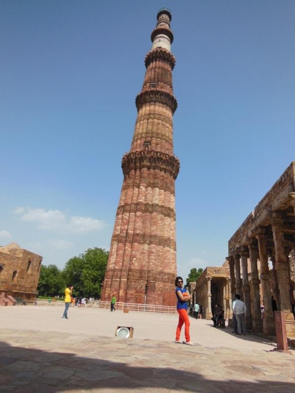 Resting against Qutab Minar