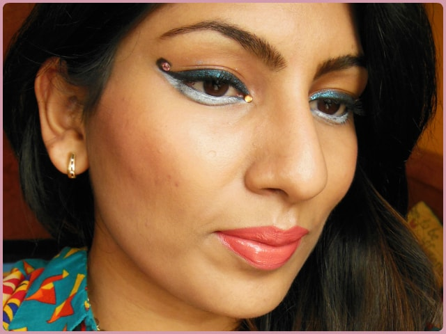 Curved Cat Eyes and Coral Lips Makeup Look